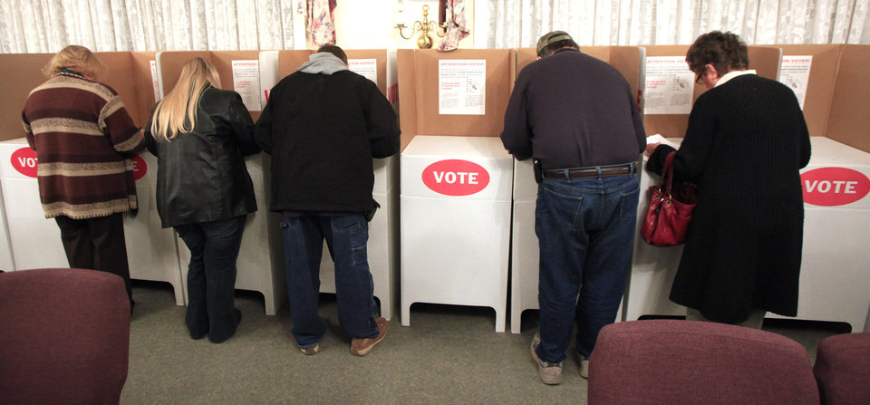 Photo - Voters in  Oklahoma City's precinct 460 cast ballots in the Nov. 2, 2010, election. Photo by Paul B. Southerland, The Oklahoman Archive