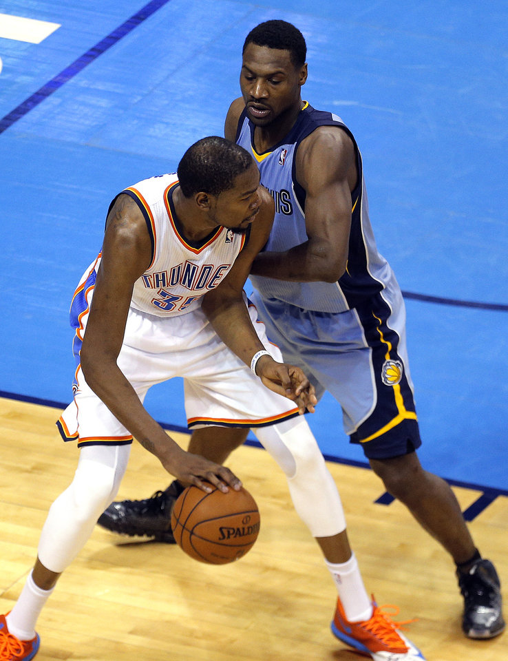 Photo - Memphis' Tony Allen (9) defends against Oklahoma City's Kevin Durant (35) during Game 2 in the first round of the NBA playoffs between the Oklahoma City Thunder and the Memphis Grizzlies at Chesapeake Energy Arena in Oklahoma City, Monday, April 21, 2014. Photo by Sarah Phipps, The Oklahoman