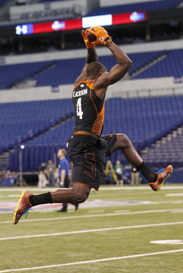 Oklahoma State receiver Justin Blackmon runs a drill at the NFL football scouting combine in Indianapolis on Sunday, Feb. 26, 2012. (AP Photo/Dave Martin)