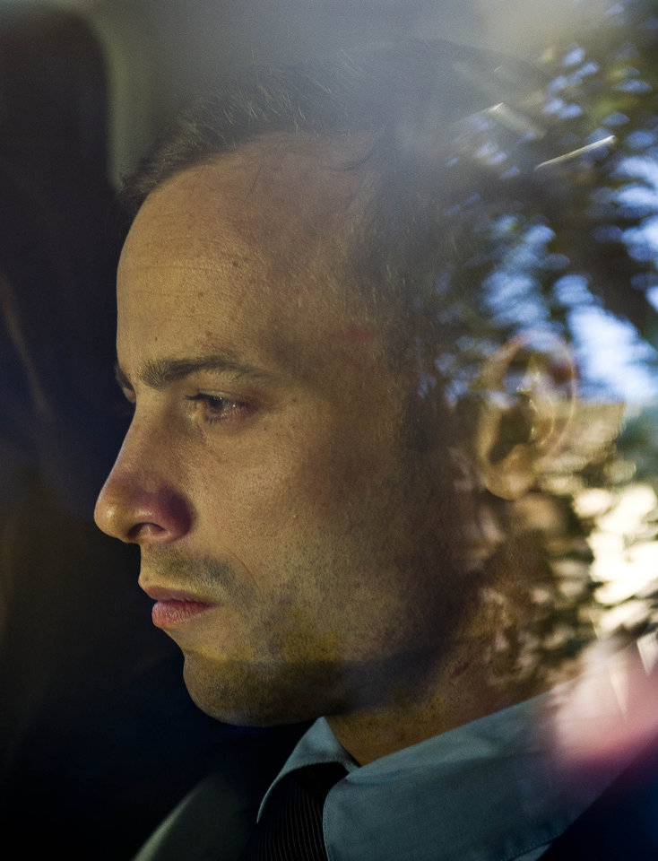 Photo - Olympic athlete Oscar Pistorius is driven to a relatives home in Pretoria, South Africa, Friday, Feb. 22, 2013. Pistorius was released on bail and will return to court June, 4, 2013 to face charge a charge of pre-meditated murder in the shooting death of his girlfriend, Reeva Steenkamp. (AP Photo/Nelius Rademan-FOTO24-Beeld) SOUTH AFRICA OUT NO SALES. NO ARCHIVE, ONLINE OUT MAGAZINES OUT INTERNET OUT TV OUT