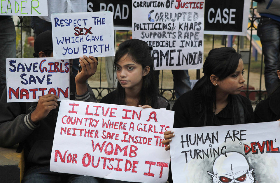 Indian students participate in a protest against a leader of the ruling Congress party on accusations he raped a woman in a village in the early hours of the morning, in Gauhati, India, Thursday, Jan. 3, 2013. Footage on Indian television showed the extraordinary scene of local women surrounding Bikram Singh Brahma, ripping off his shirt and repeatedly slapping him across the face. A Dec. 16 gang rape on a woman, who later died of her injuries, has caused outrage across India, sparking protests and demands for tough new rape laws, better police protection for women and a sustained campaign to change society\'s views about women. (AP Photo/Anupam Nath)