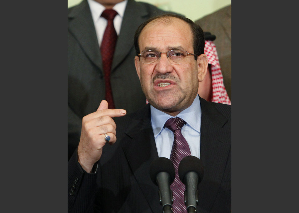 Photo - FILE - In this March 26, 2010 file photo, Iraqi Prime Minister Nouri al-Maliki speaks to the press in Baghdad, Iraq. Al-Maliki said in a statement issued by his office Friday, July 4, 2014, that he will fight until the Islamic militants who have overrun much of the country are defeated, suggesting he won't step down despite pressure for him to do so. (AP Photo/Hadi Mizban, File)