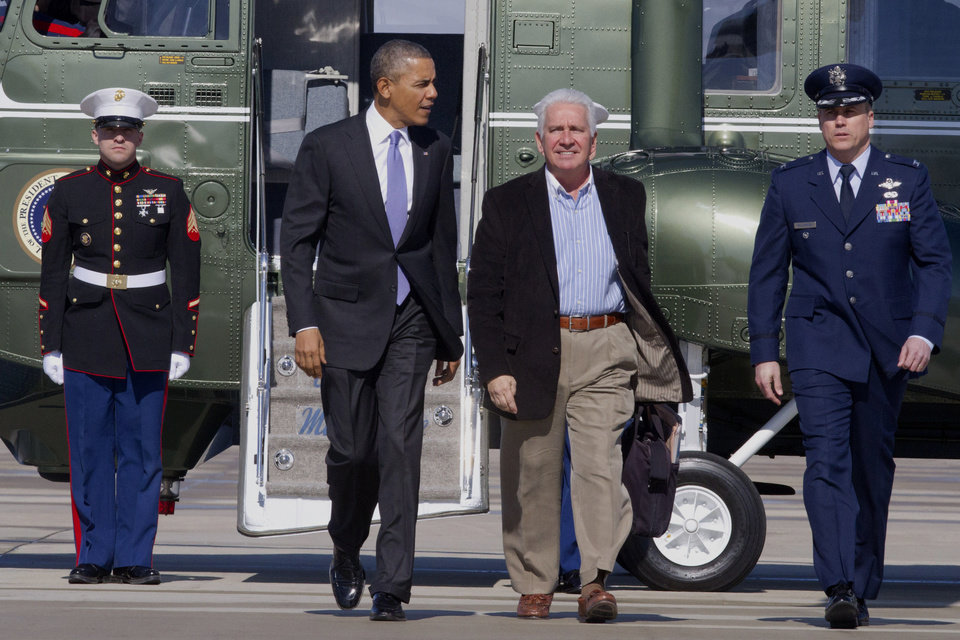 Photo - President Barack Obama and Rep. Jim Costa, D-Calif. walk from the Marine One helicopter toward Air Force One before traveling to Fresno, Calif., to discuss the ongoing drought, Friday, Feb. 14, 2014, at Andrews Air Force Base, Md. (AP Photo/Jacquelyn Martin)