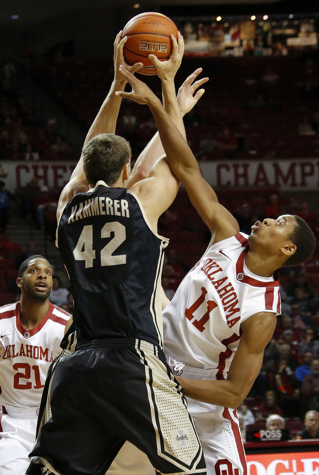 Photo - Oklahoma's Isaiah Cousins (11) defends Idaho's Joe Kammerer (42) as Oklahoma's Cameron Clark (21) watches during a college basketball game between the University of Oklahoma Sooners and the Idaho Vandals at Lloyd Noble Center in Norman, Okla., on Wednesday, Nov. 13, 2013. Wednesday, Nov. 13, 2013. Photo by Bryan Terry, The Oklahoman