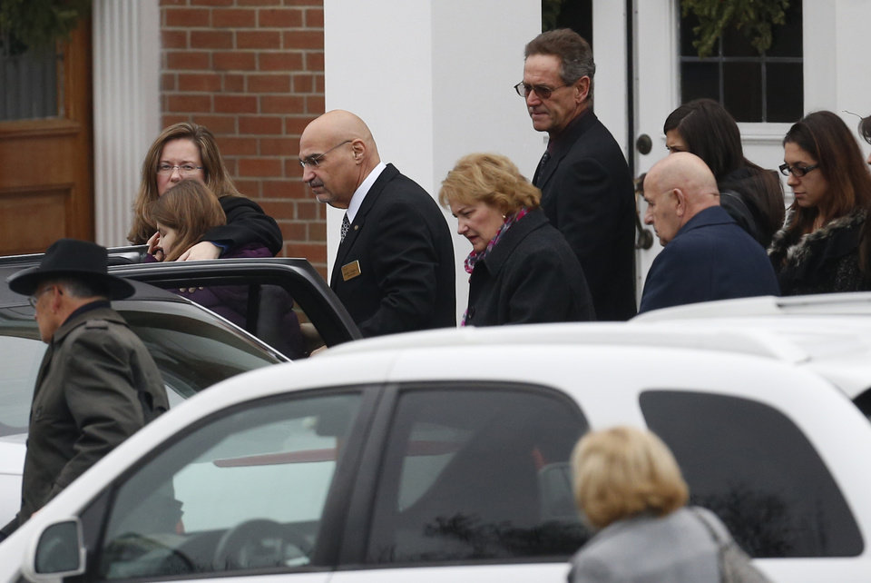 Photo - Mourners arrive at St. Rose of Lima Roman Catholic Church during funeral services for James Mattioli, Tuesday, Dec. 18, 2012, in Newtown, Conn. Mattioli, 6, was killed when Adam Lanza walked into Sandy Hook Elementary School in Newtown, Conn., Dec. 14,  and opened fire, killing 26 people, including 20 children, before killing himself.  (AP Photo/Julio Cortez)