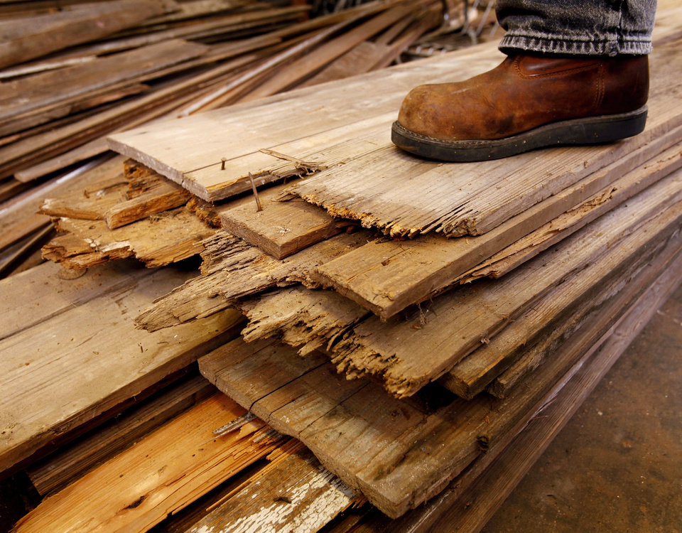 Photo - Old boards stacked in a back room of the  Okemah Historical Society Museum on W. Broadway in downtown Okemah.  The wood will be used to reconstruct the Woody Guthrie