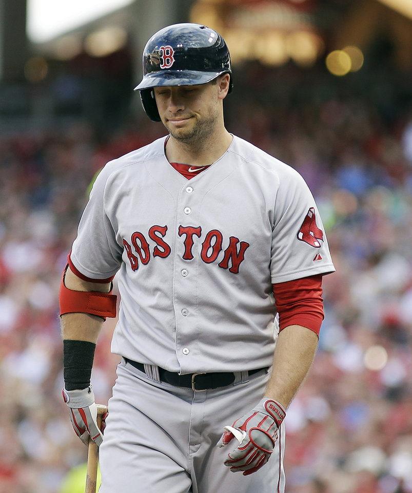 Photo - Boston Red Sox's Daniel Nava reacts after striking out against Cincinnati Reds pitcher Mat Latos in the first inning of a baseball game, Tuesday, Aug. 12, 2014, in Cincinnati. (AP Photo/Tony Tribble)