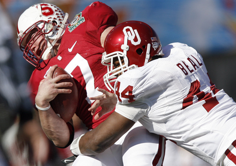 Oklahoma's Jeremy Beal (44) brings down Stanford's Toby Gerhart 97) during the first half of the Brut Sun Bowl college football game between the University of Oklahoma Sooners (OU) and the Stanford University Cardinal on Thursday, Dec. 31, 2009, in El Paso, Tex.   Photo by Chris Landsberger, The Oklahoman