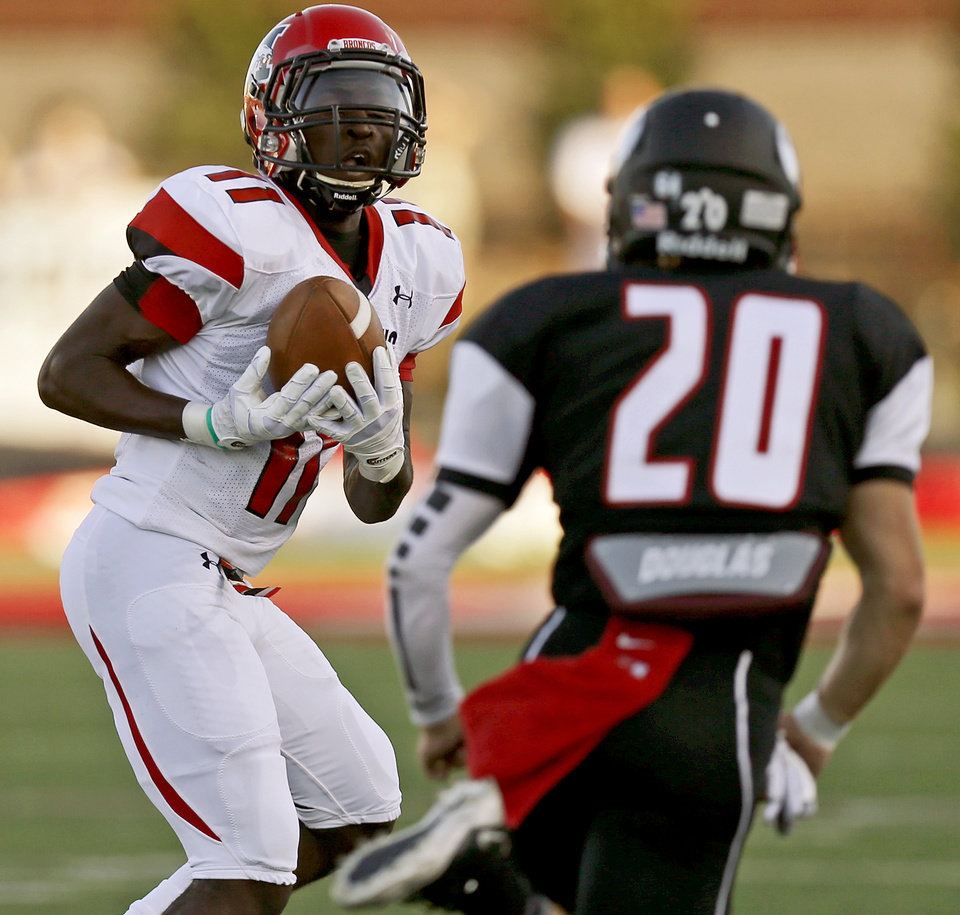 Photo - Mustang's Travis Mitchell catches a pass in front of Yukon's Parker Bohannan for a touchdown during a high school football game in Yukon, Okla., Friday, August 31, 2012. Photo by Bryan Terry, The Oklahoman