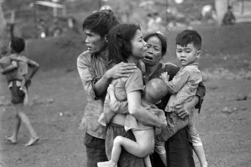 Photo -   FILE - In this June 1965 file photo shot by Associated Press photographer Horst Faas, South Vietnamese civilians, among the few survivors of two days of heavy fighting, huddle together in the aftermath of an attack by government troops to retake the post at Dong Xoai, Vietnam. Faas, a prize-winning combat photographer who carved out new standards for covering war with a camera and became one of the world's legendary photojournalists in nearly half a century with The Associated Press, died Thursday May 10, 2012. He was 79. (AP Photo/Horst Faas)