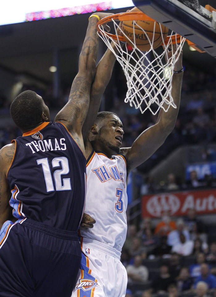 Photo -   Oklahoma City Thunder forward Perry Jones (3) dunks in front of Charlotte Bobcats forward Tyrus Thomas (12) during the first quarter of a preseason NBA basketball game in Oklahoma City, Tuesday, Oct. 16, 2012. (AP Photo/Sue Ogrocki)