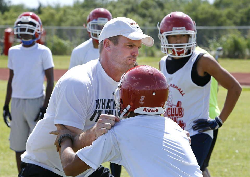 Photo - Offensive line coach Billy Bajema at John Marshall's opening practice, Monday, August 11, 2014. Photo by David McDaniel, The Oklahoman