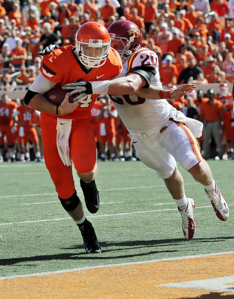 Oklahoma State\'s J.W. Walsh (4) carries the ball for a touchdown in the fourth quarter as Iowa State\'s Jake Knott (20) tries to stop him during a college football game between Oklahoma State University (OSU) and Iowa State University (ISU) at Boone Pickens Stadium in Stillwater, Okla., Saturday, Oct. 20, 2012. OSU won, 31-10. Photo by Nate Billings, The Oklahoman