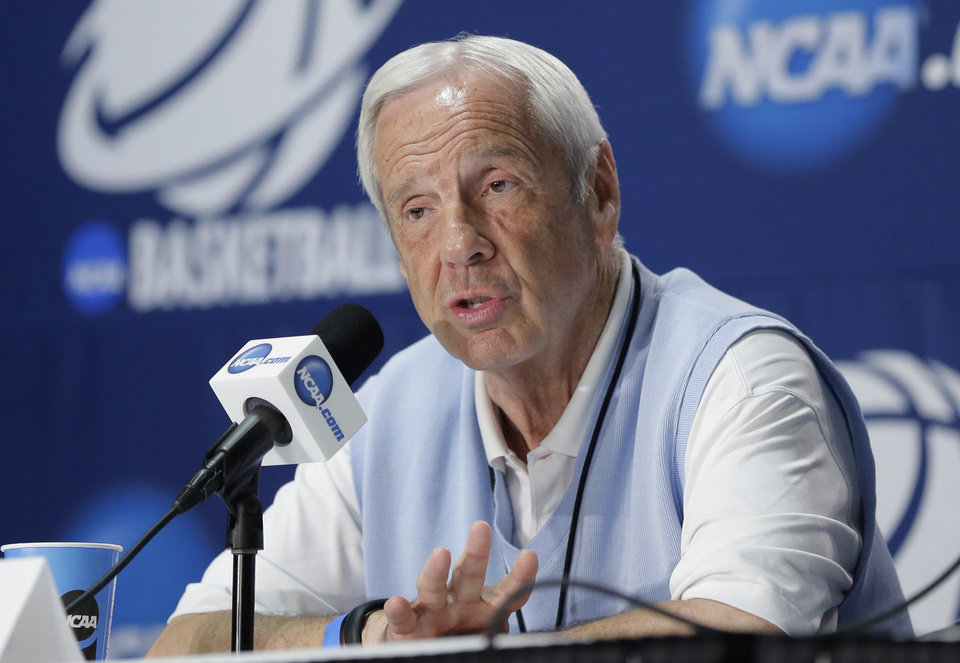 Photo - North Carolina coach Roy Williams answers a question during an NCAA college basketball tournament news conference, Saturday, March 22, 2014, in San Antonio. North Carolina will play Iowa State on Sunday. (AP Photo/Eric Gay)