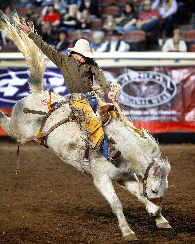Shane Hand holds on to his rope on this wild ride in the saddle bronc event during the Saturday afternoon session, 2nd go-round of the 42nd International Finals Rodeo (IFR) in the arena at State Fair Park, Jan. 14, 2012,    Photo by Jim Beckel, The Oklahoman