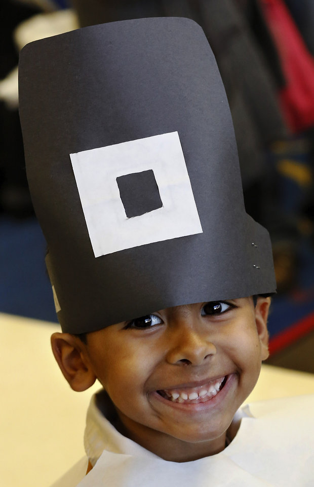 A boy in Connie Dotson's class grins beneath his pilgrim hat. Kindergarten students in Soldier Creek Elementary School in Midwest City dressed as pilgrims and Indians as they celebrated a Thanksgiving meal in their classrooms on Tuesday,  Nov. 20, 2012.   Photo by Jim Beckel, The Oklahoman