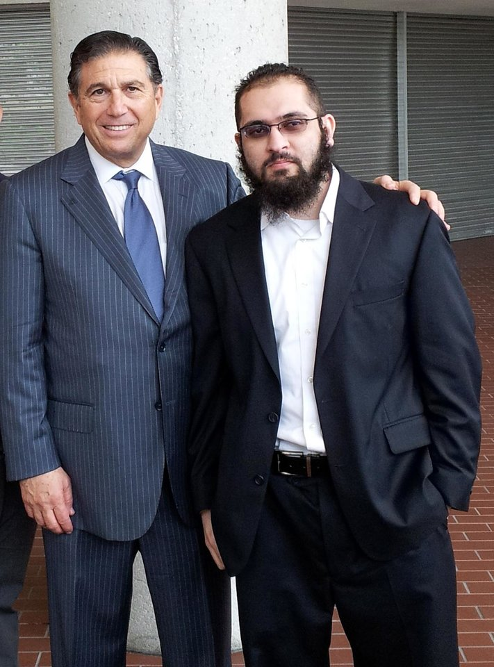 In this photo made available by law firm of Joseph Rosenbaum, P.A, shows attorney Joseph Rosenbaum, left, and his client Izhar Khan, outside the Federal Courthouse in Miami Thursday, Jan. 17, 2013. A federal judge has dismissed terrorism support and conspiracy charges against Khan  who was accused with his father of funneling cash to the Pakistani Taliban. Trial for Khan's father, 77 year-old Hafiz Khan, is continuing in federal court. (AP Photo)