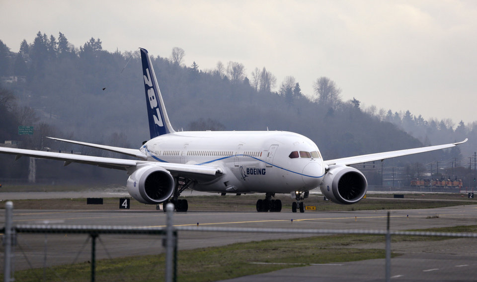 A Boeing 787 jet returns after a test flight in February at Boeing Field in Seattle. Boeing's 787 Dreamliners will be able to resume flights under a notice expected to be issued next week by the Federal Aviation Administration. AP FILE Photo