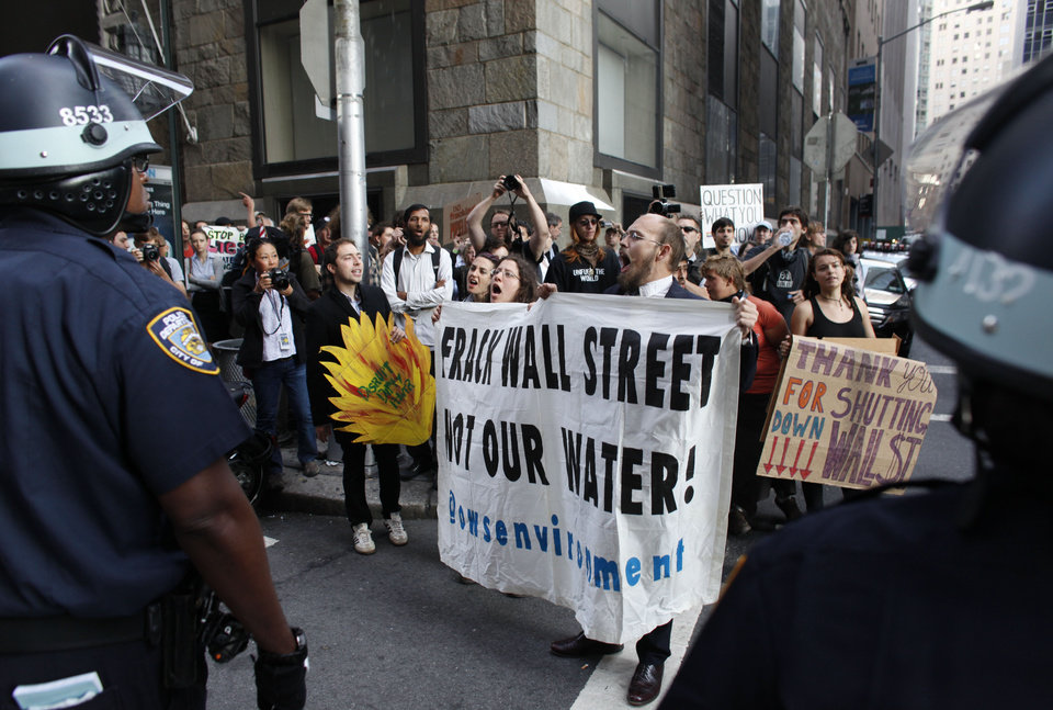 Photo -   Protestors and police face off during an Occupy Wall Street march, Monday, Sept. 17, 2012, in New York. A handful of Occupy Wall Street protestors were arrested during a march on the New York Stock Exchange on the anniversary of the grass-roots movement. (AP Photo/Jason DeCrow)