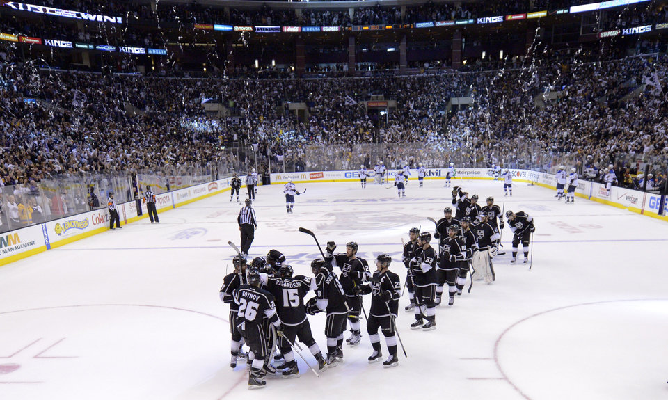 Photo -   Members of the Los Angeles Kings celebrate after Game 4 of an NHL hockey Stanley Cup second-round playoff series against the St. Louis Blues, Sunday, May 6, 2012, in Los Angeles. The Kings won 3-1 and took the series 4-0. (AP Photo/Mark J. Terrill)