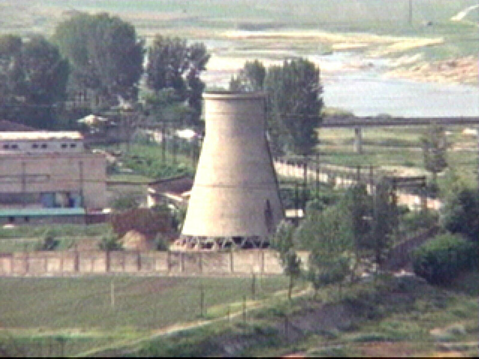 Photo - FILE - In this June 27, 2008 file photo from television, the 60-foot-tall cooling tower is seen before its demolition at the main Nyongbyon reactor complex in Nyongbyon,  also known as Yongbyon, North Korea.  North Korea vowed Tuesday, April 2, 2013, to restart a nuclear reactor that can make one bomb's worth of plutonium a year, escalating tensions already raised by near daily warlike threats against the United States and South Korea. The North's plutonium reactor was shut down in 2007 as part of international nuclear disarmament talks that have since stalled. The declaration of a resumption of plutonium production — the most common fuel in nuclear weapons — and other facilities at the main Nyongbyon nuclear complex will boost fears in Washington and among its allies about North Korea's timetable for building a nuclear-tipped missile that can reach the United States, technology it is not currently believed to have.  (AP Photo/APTN, File)