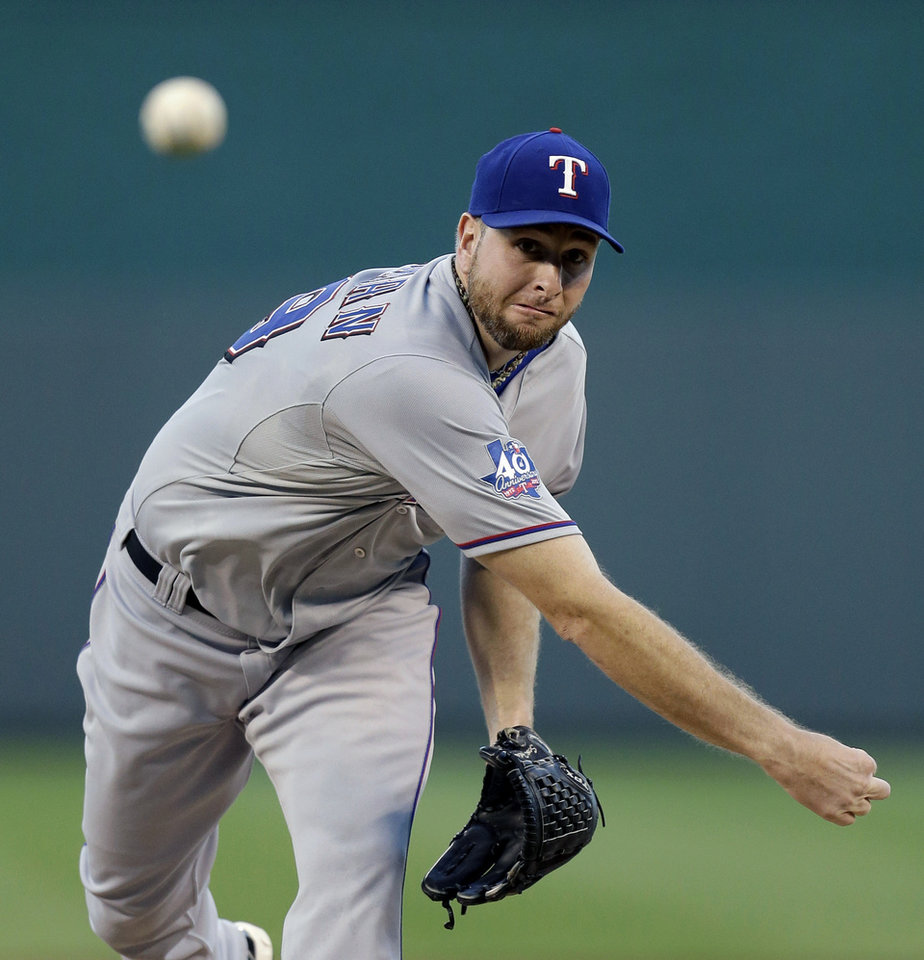 Photo -   Texas Rangers starting pitcher Scott Feldman throws during the first inning of a baseball game against the Kansas City Royals, Thursday, Sept. 6, 2012, in Kansas City, Mo. (AP Photo/Charlie Riedel)