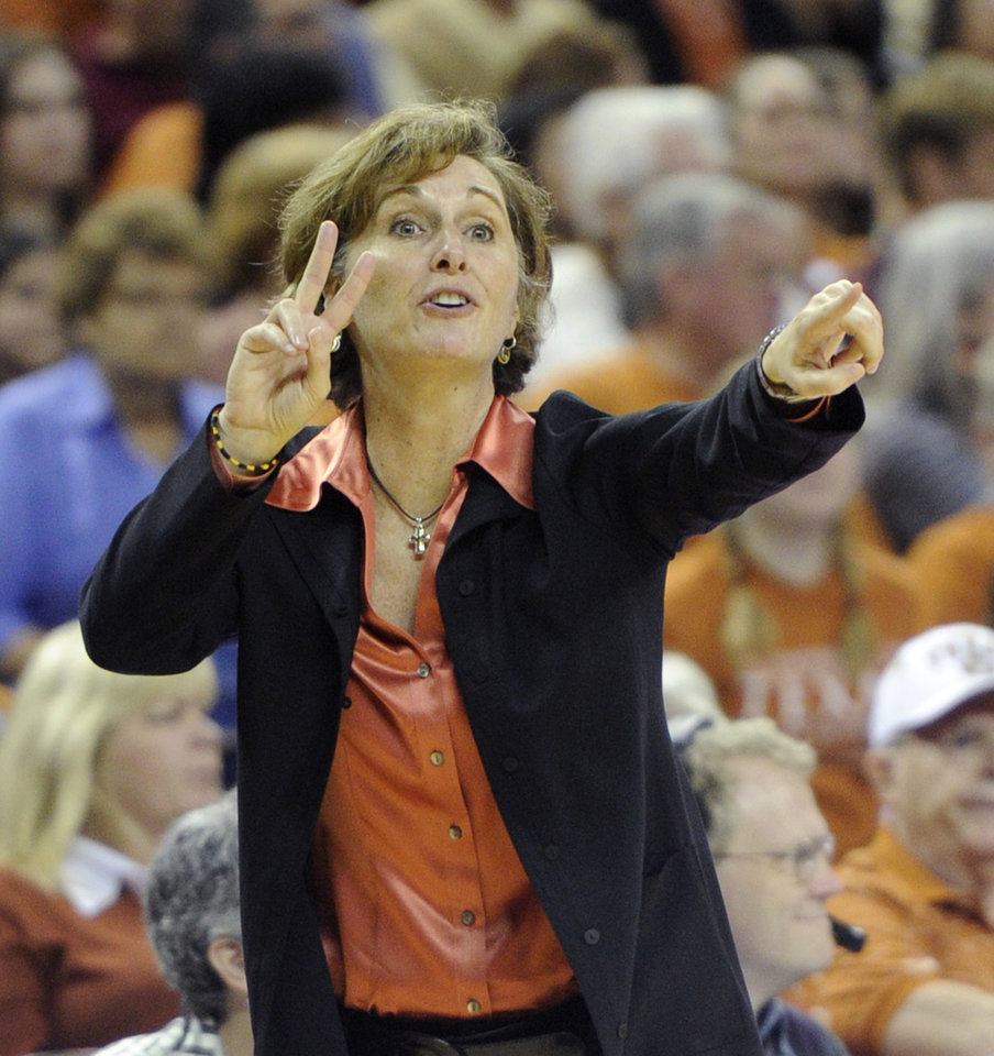 Photo - FILE - In this Feb. 27, 2011, file photo, Texas women's basketball coach Gail Goestenkors directs her team against Texas A&M during the second half of an NCAA college basketball game  in Austin, Texas.  Goestenkors was selected for the 2015 women's basketball Hall of Fame induction class announced Saturday, July 19, 2014. (AP Photo/Michael Thomas, File)
