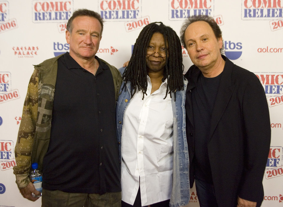 "Photo - Comedians Robin Williams, Whoopi Goldberg and Billy Crystal pose after hoasting ""Comic Relief"" at Caesars Palace Hotel and Casino in Las Vegas. (AP Photo/ Keith Shimada) ORG XMIT: NVKS130"