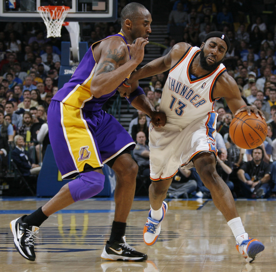 Oklahoma Xity's James Harden (13) reacts after being fouled by Kobe Bryant (24) of Los Angeles during the NBA basketball game between the Los Angeles Lakers and the Oklahoma City Thunder at the Ford Center in Oklahoma City, Friday, March 26, 2010. Photo by Nate Billings, The Oklahoman