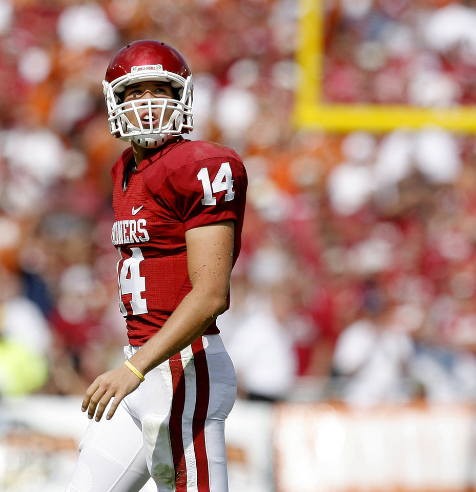 Photo - UNIVERSITY OF OKLAHOMA / OU / COLLEGE FOOTBALL / TEXAS / QUARTERBACK: OU's Sam Bradford looks up ater throwing an interception during the first half of the college football game between the University of Oklahoma Sooners (OU) and University of Texas Longhorns (UT) in the Red River Rivalry on Saturday, Oct. 11, 2008, at the Cotton Bowl, in Dallas, Tx.   BRYAN TERRY, THE OKLAHOMAN  ORG XMIT: KOD