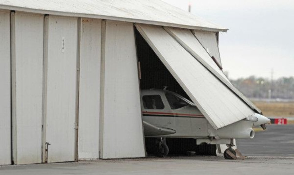 An airplane blown through a hangar shows damage from Monday nights severe weather at Max Westheimer Airport in Norman Tuesday. <strong>STEVE SISNEY - THE OKLAHOMAN</strong>