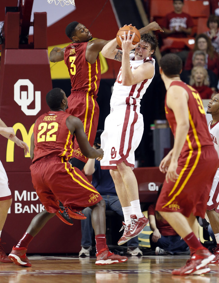 Oklahoma Sooner's Ryan Spangler (00) gets a rebound from Iowa State Cyclone's Melvin Ejim (3) as the University of Oklahoma Sooners (OU) men play the Iowa State Cyclones (ISU) in NCAA, college basketball at The Lloyd Noble Center on Saturday, Jan. 11, 2014  in Norman, Okla. Photo by Steve Sisney, The Oklahoman