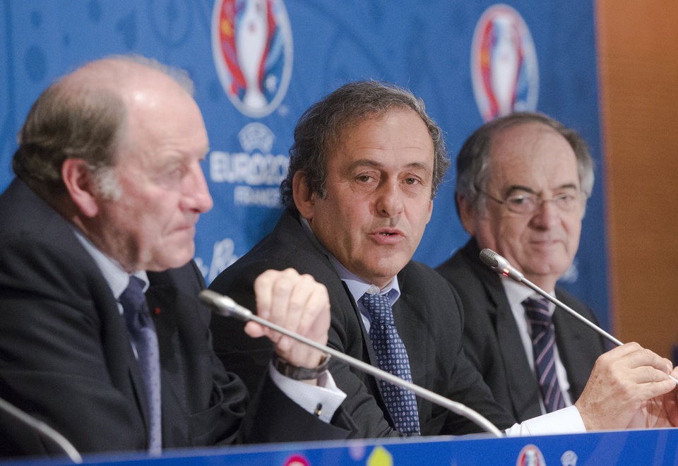Photo - French President of the Euro 2016 organizing committee Jacques Lambert, left, UEFA president Michel Platini, center, and President of the French soccer Federation  Noel Le Graet attend a press conference for the presentation of the 2016 European Football Championship in Paris, Friday April 25, 2014. The Euro 2016 championship will run from June 10 to July 10, 2016. (AP Photo/Jacques Brinon)