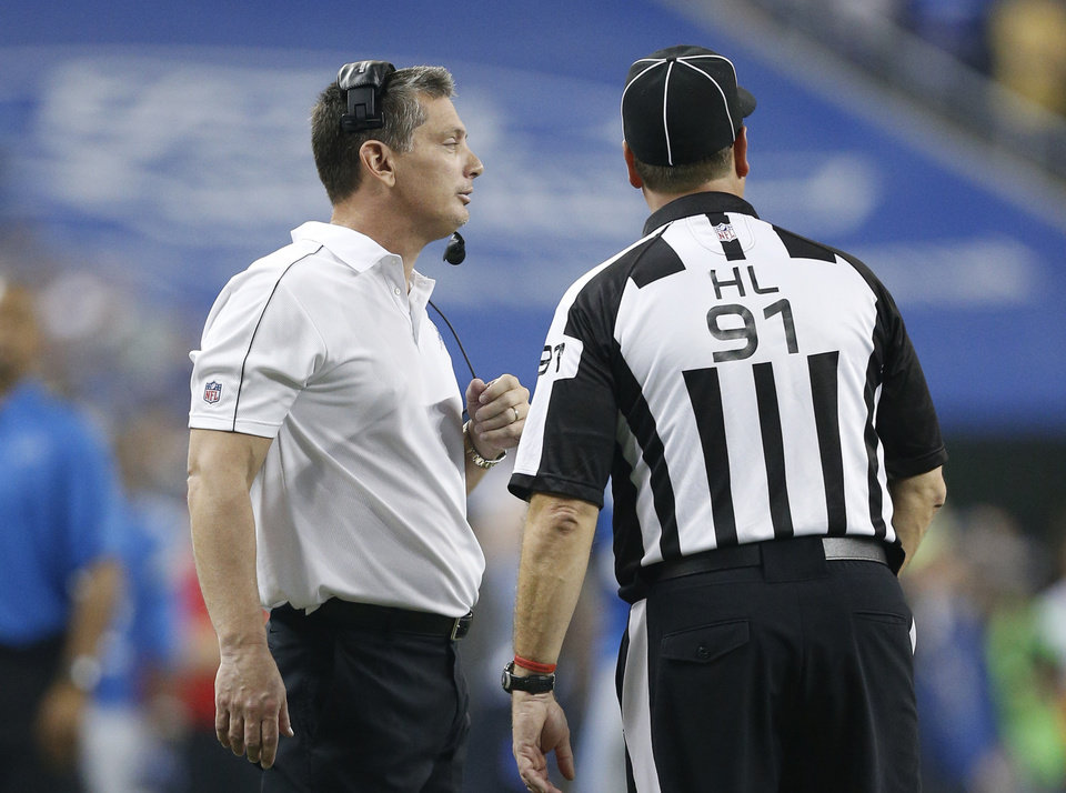 Photo -   Detroit Lions head coach Jim Schwartz talks with head linesman Jerry Bergman (91) during overtime of an NFL football game against the Houston Texans at Ford Field in Detroit, Thursday, Nov. 22, 2012. (AP Photo/Rick Osentoski)