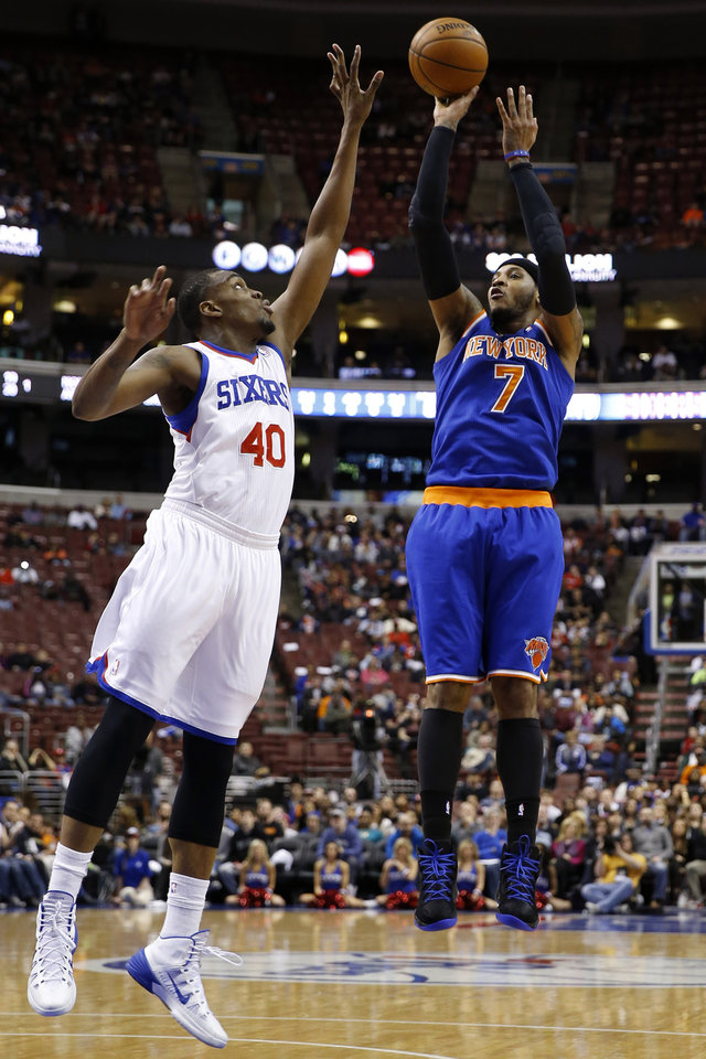 Photo - New York Knicks' Carmelo Anthony (7) goes up for a shot against Philadelphia 76ers' Jarvis Varnado (40) during the first half of an NBA basketball game, Friday, March 21, 2014, in Philadelphia. (AP Photo/Matt Slocum)