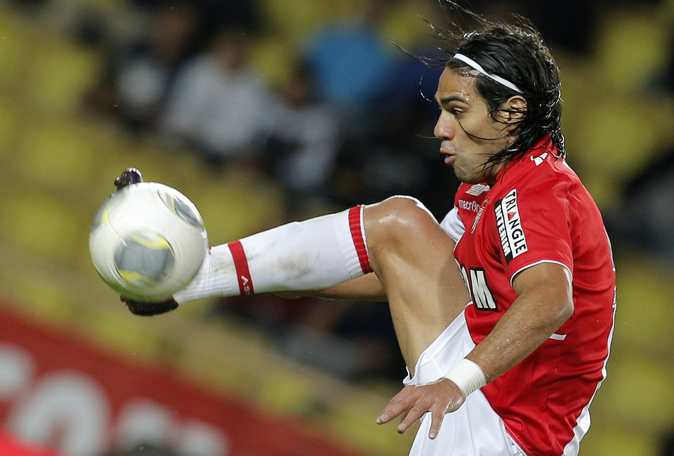 Photo - FILE - This is a Friday, Nov. 8, 2013 file photo of Monaco's  Radamel Falcao of Colombia as he controls the ball during his French League One soccer match against Evian, in Monaco stadium.   Radamel Falcao is set to join Manchester United on loan after the Premier League club agreed to a loan deal with Monaco, a person with knowledge of the deal said Monday Sept. 1, 2014. (AP Photo/Lionel Cironneau, File)