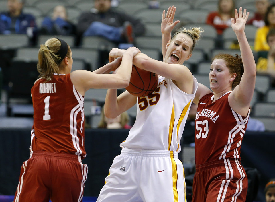 Iowa State's Anna Prins (55) fights for the ball with Oklahoma's Nicole Kornet (1) and Joanna McFarland (53) during the Big 12 tournament women's college basketball game between the University of Oklahoma and Iowa State University at American Airlines Arena in Dallas, Sunday, March 10, 2012.  Oklahoma lost 79-60. Photo by Bryan Terry, The Oklahoman