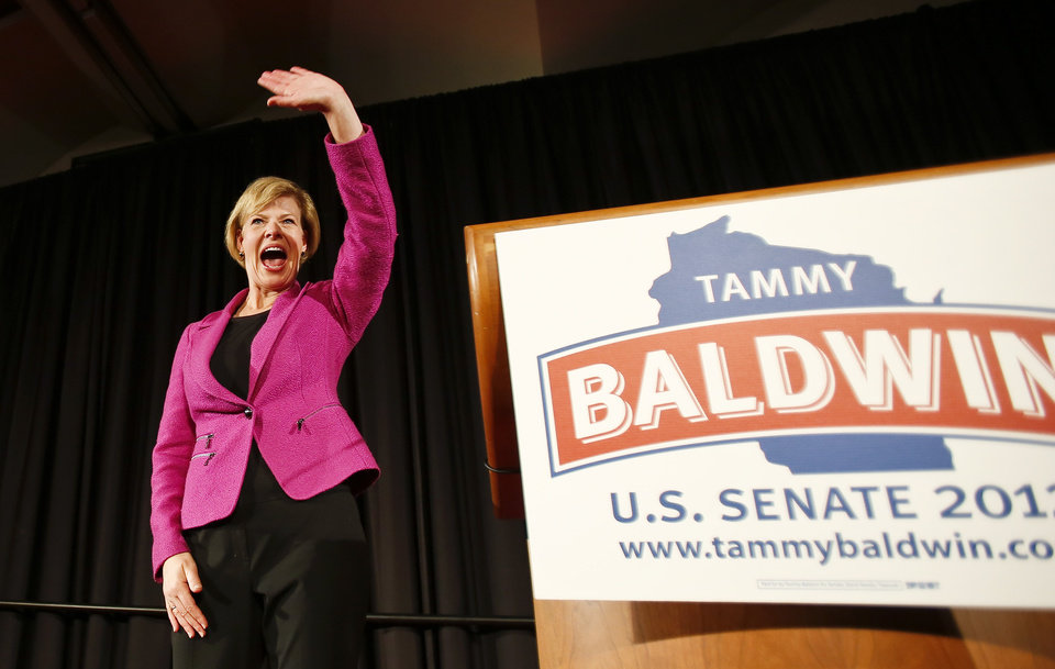 U.S. Rep. Tammy Baldwin, D-Wis., waves to supporters after making her a victory speech in Wisconsin\'s U.S. Senate race, Tuesday, Nov. 6, 2012, in Madison, Wis. Baldwin defeated former Wisconsin Gov. Tommy Thompson, to become the nation\'s first openly gay senator. (AP Photo/Andy Manis)