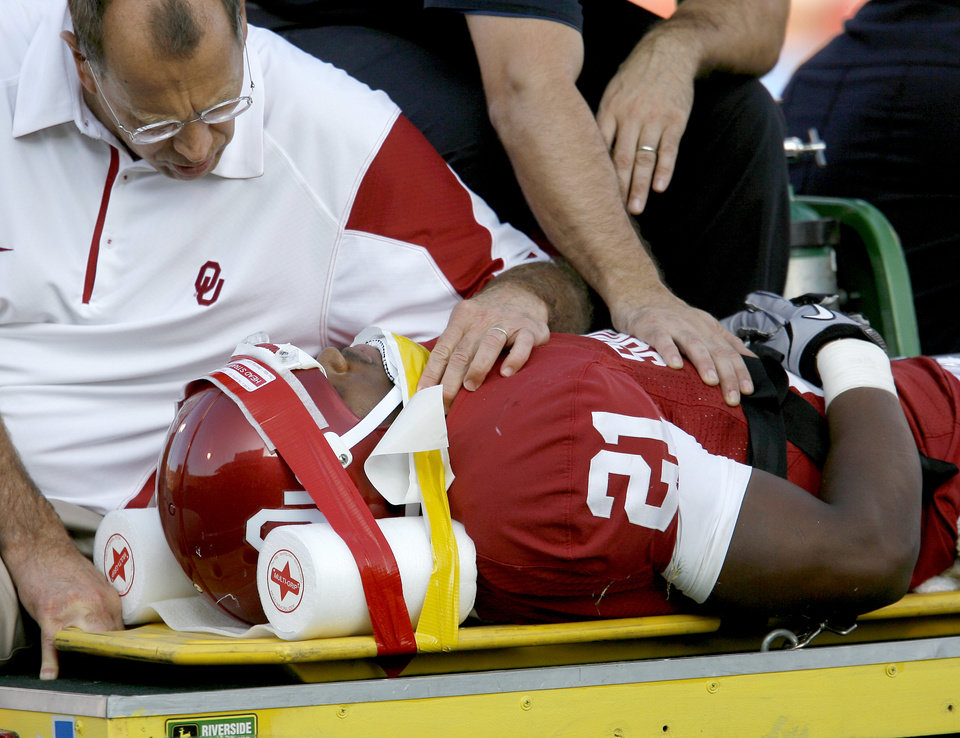 Photo - OU's Brennan Clay is taken off the field after an injury during the second half of the college football game between the University of Oklahoma Sooners (OU) and Florida State University Seminoles (FSU) at the Gaylord Family-Oklahoma Memorial Stadium on Saturday, Sept. 11, 2010, in Norman, Okla.   Photo by Bryan Terry, The Oklahoman