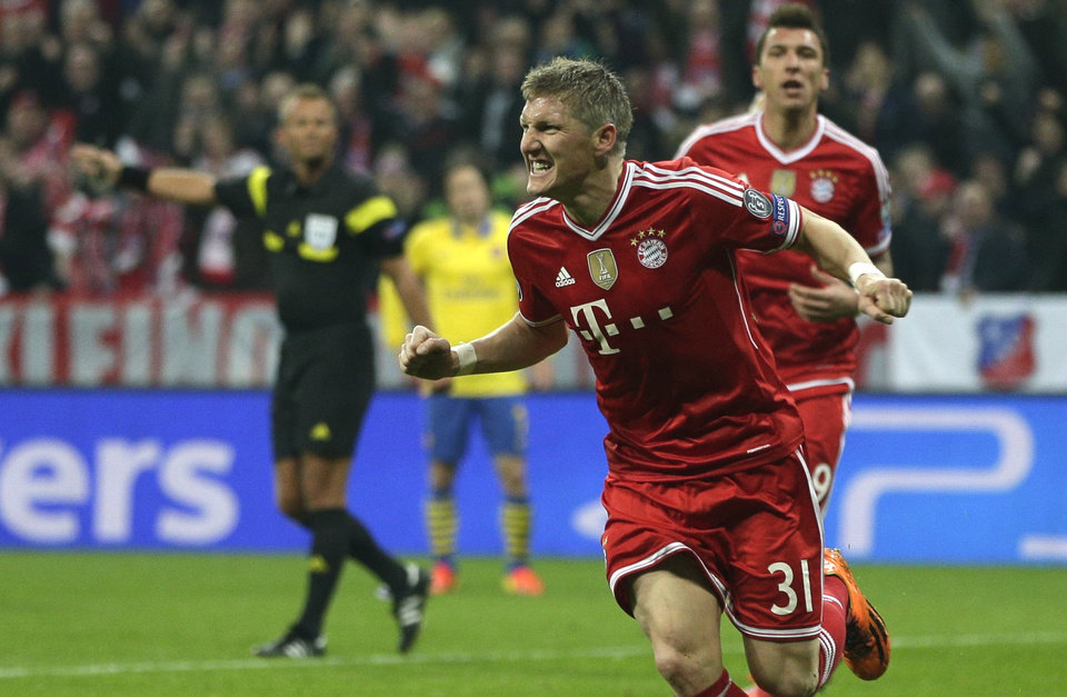 Photo - Bayern's Bastian Schweinsteiger celebrates scoring the opening goal during the Champions League round of 16 second leg soccer match between FC Bayern Munich and FC Arsenal in Munich, Germany, Wednesday, March 12, 2014. (AP Photo/Matthias Schrader)