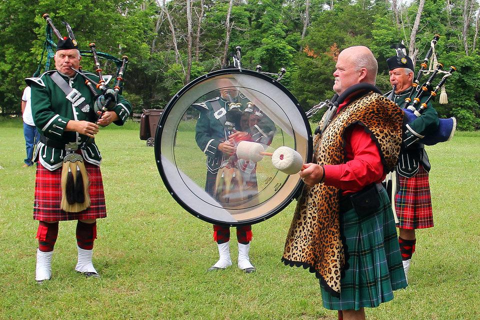 Members of the Pipes and Drums of the Highlands of Oklahoma City perform during the Iron Thistle Festival in Yukon, Saturday, April 28th, 2012. PHOTO BY HUGH SCOTT, FOR THE OKLAHOMAN ORG XMIT: KOD
