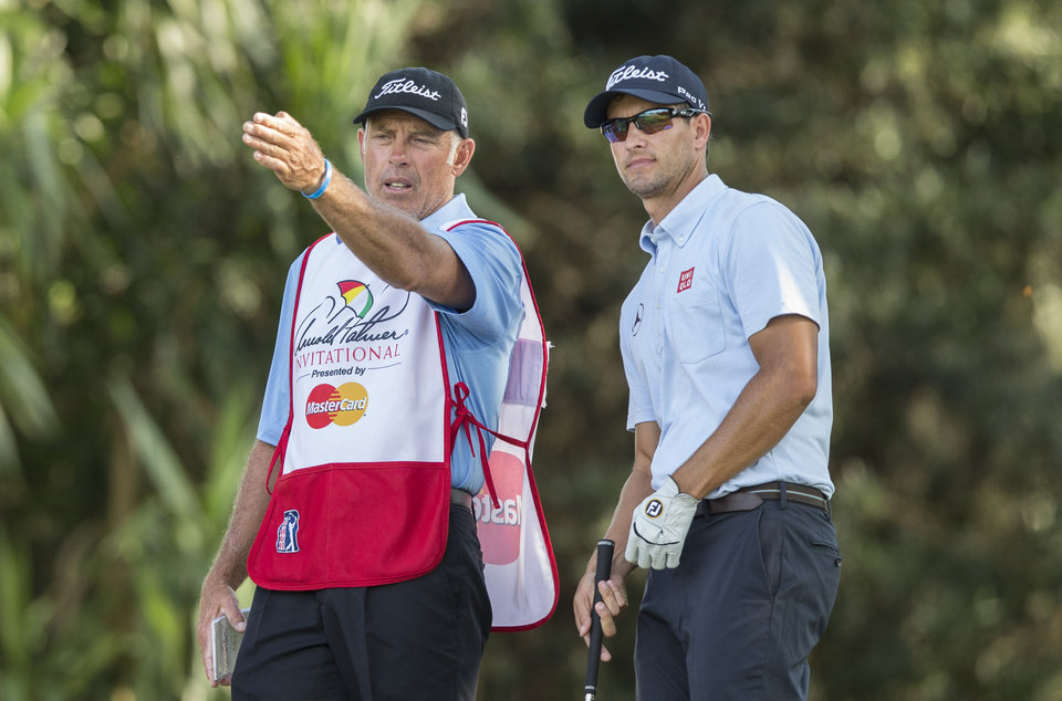 Photo - Caddie Steve Williams, left, and Adam Scott discuss strategy on the 17th hole tee during the second round of the Arnold Palmer Invitational golf tournament at Bay Hill Friday March 21, 2014, in Orlando, Fla. (AP Photo/ Willie J. Allen Jr.)