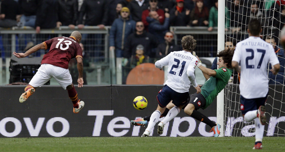Photo - AS Roma defender Maicon of Brazil, right, scores during a Serie A soccer match between AS Roma and Genoa, at Rome's Olympic Stadium, Sunday, Jan. 12, 2014. (AP Photo/Andrew Medichini)