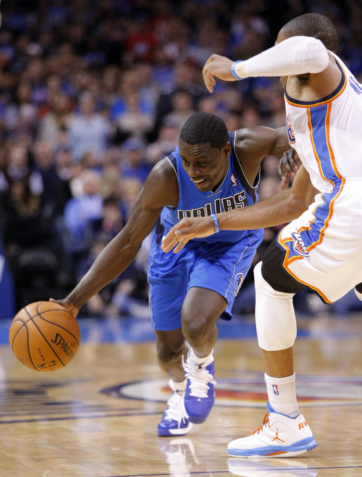 Dallas Mavericks Darren Collison, left, drives to the basket around Oklahoma City Thunder guard Russell Westbrook, right, during the second quarter of an NBA basketball game in Oklahoma City, Thursday, Dec. 27, 2012. (AP Photo/Alonzo Adams)