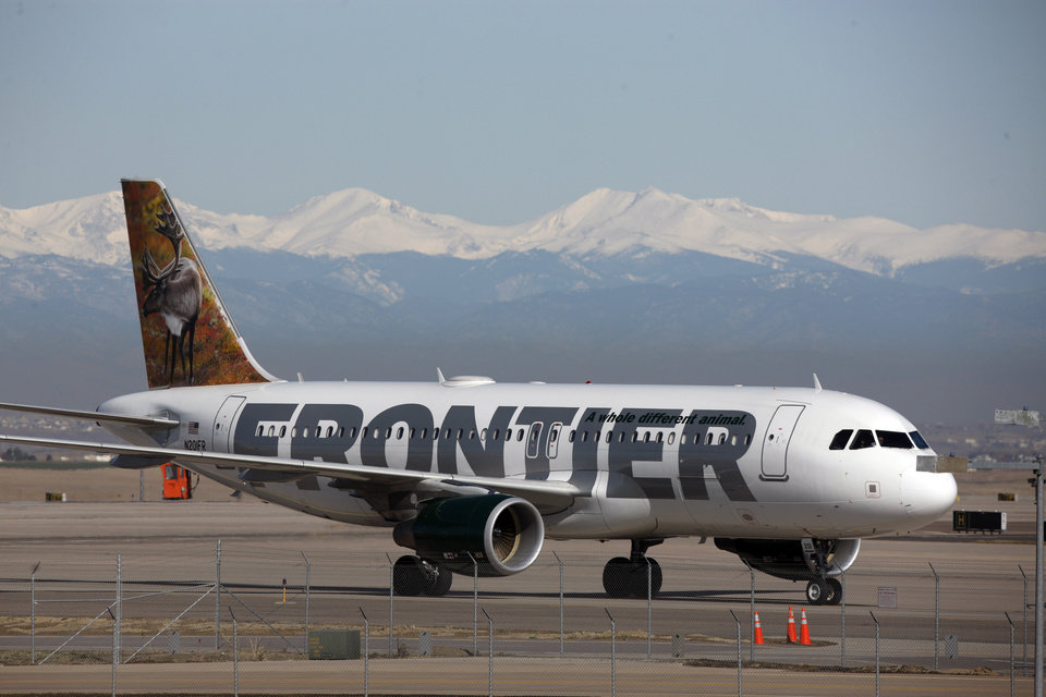 Photo - FILE - In this Thursday, April 8, 2010 file photo, a Frontier Airlines jetliner arrives at Denver International Airport. Carriers are offering more deals to passengers who book flights directly on their websites. Frontier Airlines is the latest carrier to jump into the fight, announcing Wednesday, Sept. 12, 2012, that it will penalize passengers who don't book directly with the airline. (AP Photo/David Zalubowski, File) ORG XMIT: NYBZ120