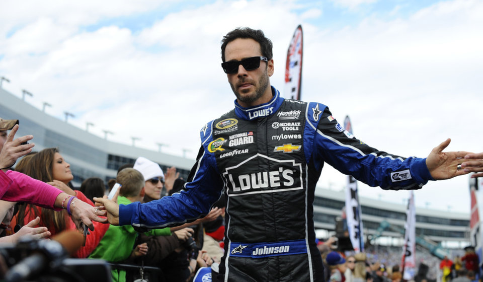 Photo - Jimmie Johnson greets fans during driver introductions before the NASCAR Sprint Cup series auto race at Texas Motor Speedway in Fort Worth, Texas, Sunday, Nov. 3, 2013. (AP Photo/Ralph Lauer)