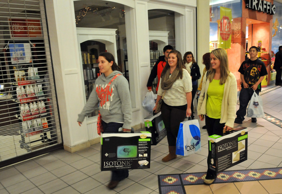 Sarah Swaggert, Ellen Danos, and Erica Stewart head to the next store with their first purchases in hand during Black Friday shopping at Oglethorpe Mall in Savannah, Ga. on Friday, Nov. 23, 2012. (AP Photo/The Morning News, Richard Burkhart) THE EXAMINER.COM OUT; SFEXAMINER.COM OUT; WASHINGTONEXAMINER.COM OUT