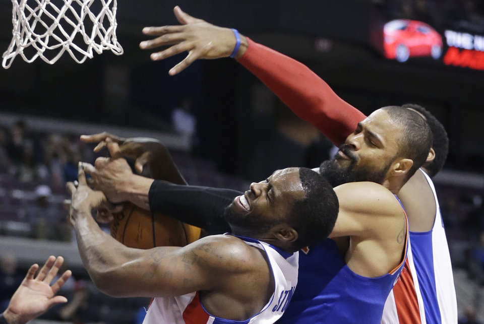 Photo - Detroit Pistons guard Rodney Stuckey, left, New York Knicks center Tyson Chandler, center, and Detroit Pistons center Andre Drummond battle for the rebound during the second half of an NBA basketball game in Auburn Hills, Mich., Monday, March 3, 2014. (AP Photo/Carlos Osorio)