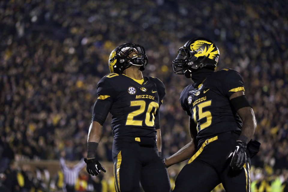 Missouri running back Henry Josey, left, is congratulated by teammate Dorial Green-Beckham after scoring on a 57-yard run during the second half of an NCAA college football game against Texas A&M on Saturday, Nov. 30, 2013, in Columbia, Mo. (AP Photo/Jeff Roberson)