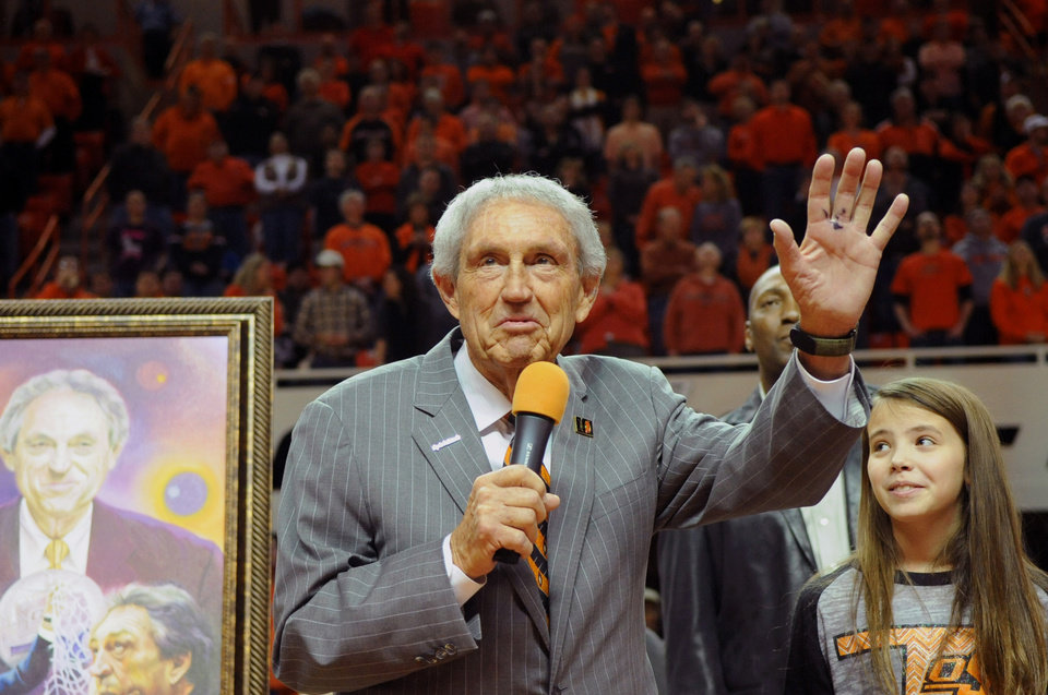 Photo - Eddie Sutton, head coach at Oklahoma State between 1990-2006, is honored at half time of the Oklahoma State basketball game against Iowa State in Stillwater, Okla., Monday, Feb. 3, 2014. (AP Photo/Brody Schmidt)